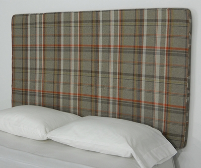 a picture of plaid fabric peel and stick upholstered wall mounted headboard
